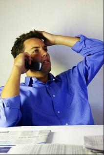 man talking on the phone to his stockbroker
